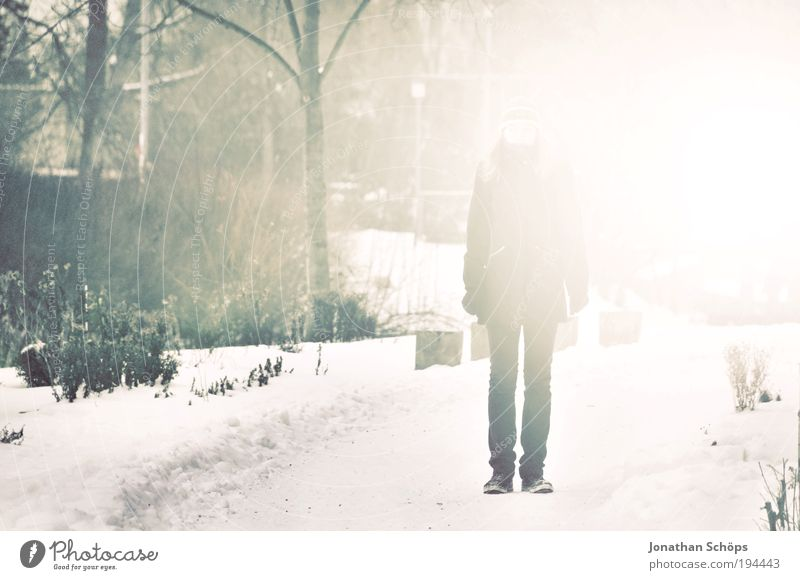 Human being White Green Loneliness Winter Emotions Lanes & trails Legs Dream Park Fog Stand Illuminate To go for a walk Anonymous Direct