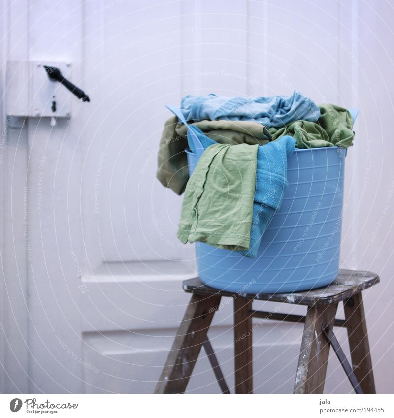 Small laundry Laundry basket Blue Green White Dirty laundry Textiles Clothing Door Ladder Colour photo Interior shot Day Washing Washing day
