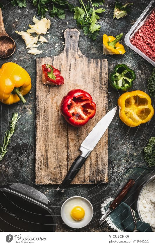 Paprika on cutting board with kitchen knife and ingredients Food Meat Vegetable Herbs and spices Nutrition Lunch Dinner Organic produce Crockery Bowl Pot Knives