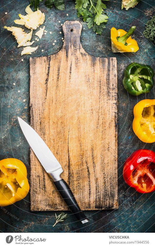 Cutting board with kitchen knife and coloured peppers Food Vegetable Lettuce Salad Herbs and spices Nutrition Organic produce Vegetarian diet Diet Crockery