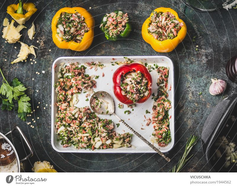 Paprika with meat filling on a rustic kitchen table Food Meat Vegetable Herbs and spices Nutrition Lunch Dinner Organic produce Crockery Pot Spoon Style Design