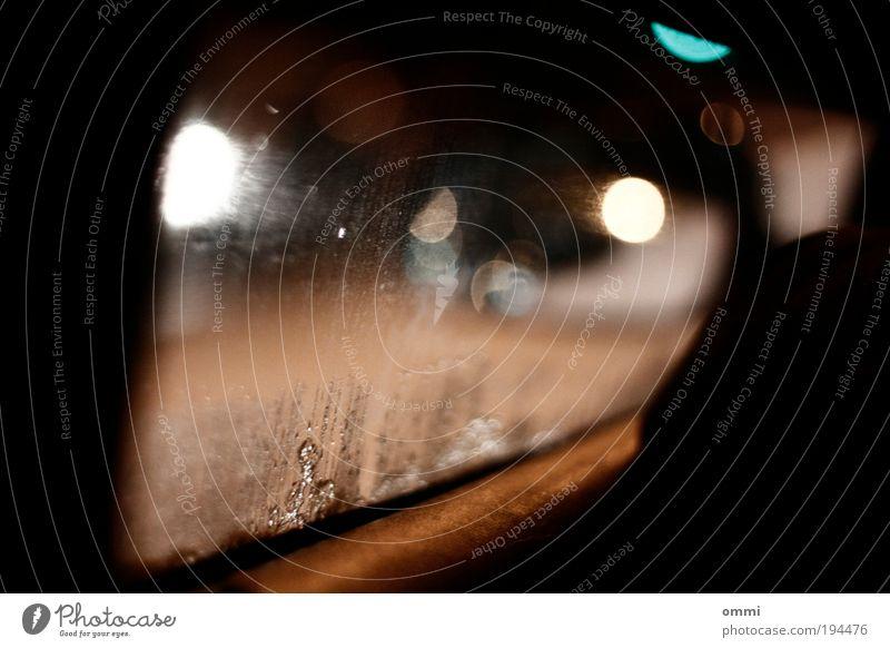night ride Road traffic Motoring Street Car Glass Driving Authentic Dirty Dark Wet Gloomy Nerviness Perspective Moody Window pane Street lighting Lantern