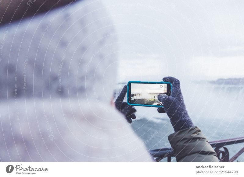 Young woman photographs Niagara Falls Contentment Vacation & Travel Tourism Trip Far-off places Freedom Sightseeing Winter Feminine Youth (Young adults) 1