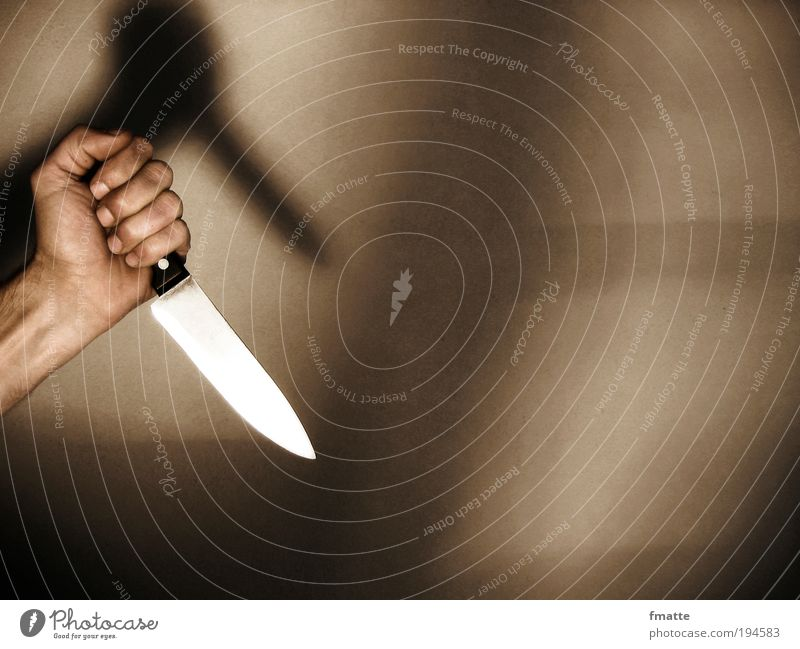 """Hand and knife Masculine """"Hand arm Knives Force Murder Attack Crime thriller,"""" Threat Dark Brown Safety Protection Fear Fear of death Dangerous Aggression"""
