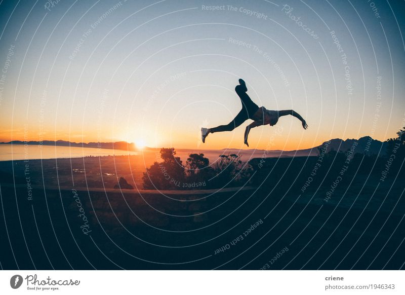 Silhouette of young adult man jumping high in sunset Human being Vacation & Travel Youth (Young adults) Man Summer Young man Landscape Joy Mountain Adults Life