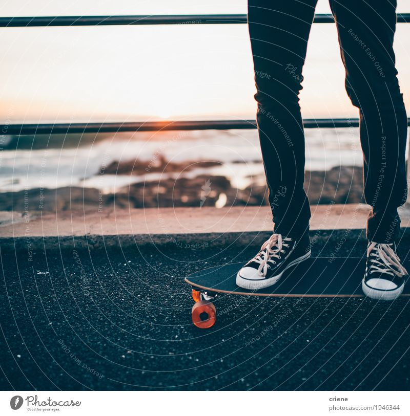 Close-up of man standing on longboard on promenade Human being Youth (Young adults) Man Young man Ocean Joy Beach Adults Lifestyle Sports Style Fashion Feet Leisure and hobbies Masculine Footwear
