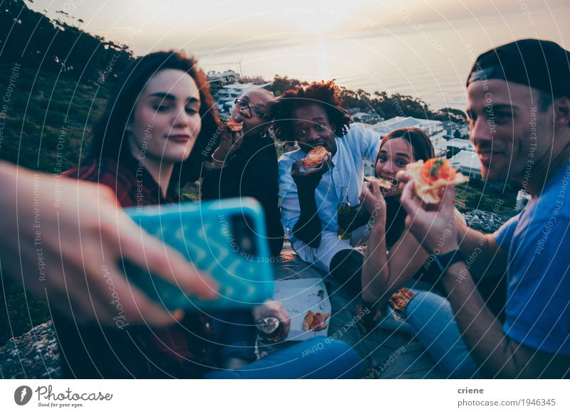 Group of mixed race young adults taking selfie Youth (Young adults) Young woman Young man Joy 18 - 30 years Adults Eating Lifestyle Freedom Group Together Friendship Sit Happiness To enjoy Smiling