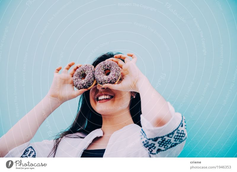 Caucasian women making funny face with chocolate donuts Human being Woman Youth (Young adults) Blue Young woman Joy Adults Eating Lifestyle Funny Feminine Food Moody Copy Space Happiness Smiling