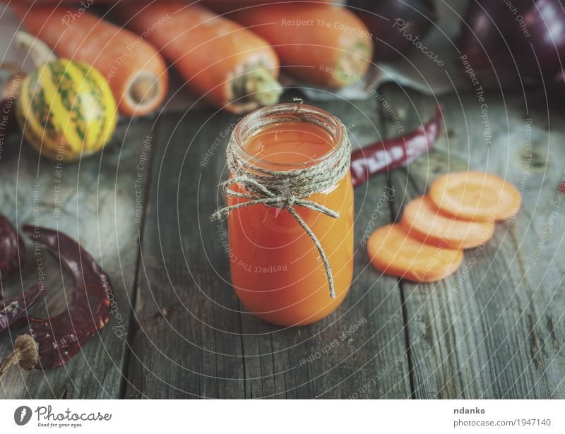 Carrot juice in a little jar among the fresh vegetables Vegetable Herbs and spices Nutrition Vegetarian diet Beverage Juice Glass Table Rope Old Fresh Healthy