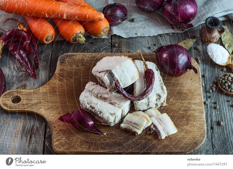 Salt pork bacon on a kitchen board Red Eating Natural Food Gray Brown Orange Fresh Table Herbs and spices Vegetable Cloth Top Slice Vitamin Spoon