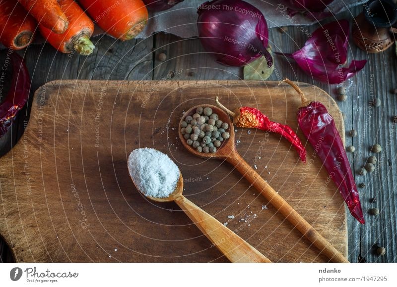 Salt and dried allspice in a wooden spoon Old Plant White Red Leaf Dish Natural Gray Brown Orange Fresh Table Herbs and spices Delicious Vegetable Cloth