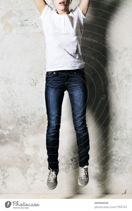 Human being Youth (Young adults) Blue White Adults Feminine Gray Jump Crazy 18 - 30 years T-shirt Young woman Jeans Thin Brave Full-length
