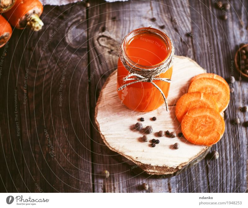 Fresh carrot juice in a glass jar on a wooden surface Nature Old Eating Autumn Natural Healthy Wood Health care Gray Above Orange Fruit Fresh Glass Table Herbs and spices