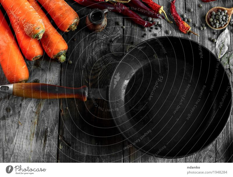 Black frying pan among the fresh vegetables Old Red Dish Eating Autumn Natural Wood Gray Orange Metal Fresh Table Herbs and spices Delicious Vegetable