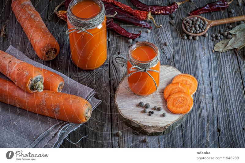 Fresh carrot juice with pulp among the vegetables Vegetable Herbs and spices Nutrition Vegetarian diet Diet Beverage Drinking Juice Bottle Table Nature Wood