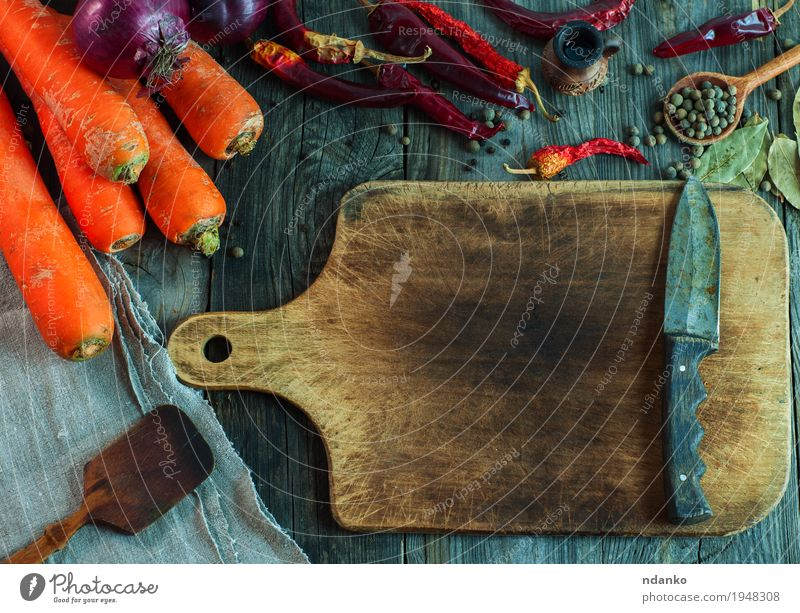 brown cutting board with a knife Food Vegetable Fruit Herbs and spices Eating Organic produce Vegetarian diet Knives Spoon Healthy Eating Table Autumn Wood Diet