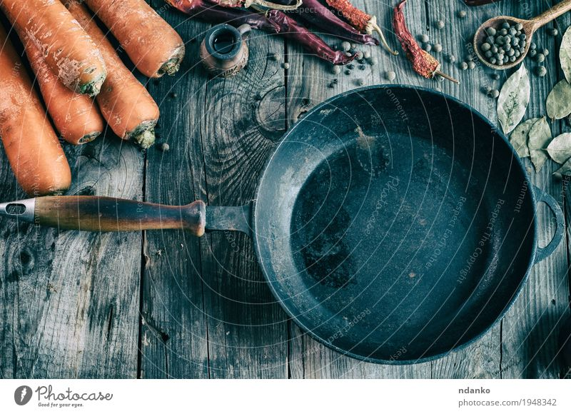 Blank black cast iron pan among the fresh vegetables Old Red Black Dish Autumn Natural Wood Gray Orange Metal Fresh Table Herbs and spices Delicious Vegetable
