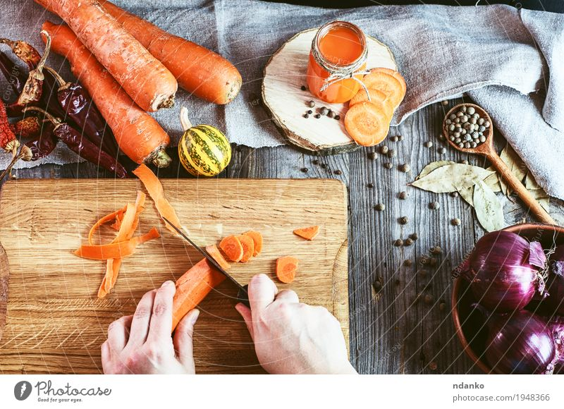 Two female hands chopped fresh carrot slices Human being Nature Youth (Young adults) Old Young woman Hand Red Leaf 18 - 30 years Adults Eating Natural Wood Gray