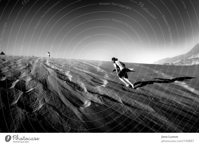 Human being Movement Sand Going Masculine Gloomy Desert Sports Dry Bizarre Surfer Chile Black & white photo Swimming trunks Surfboard Time