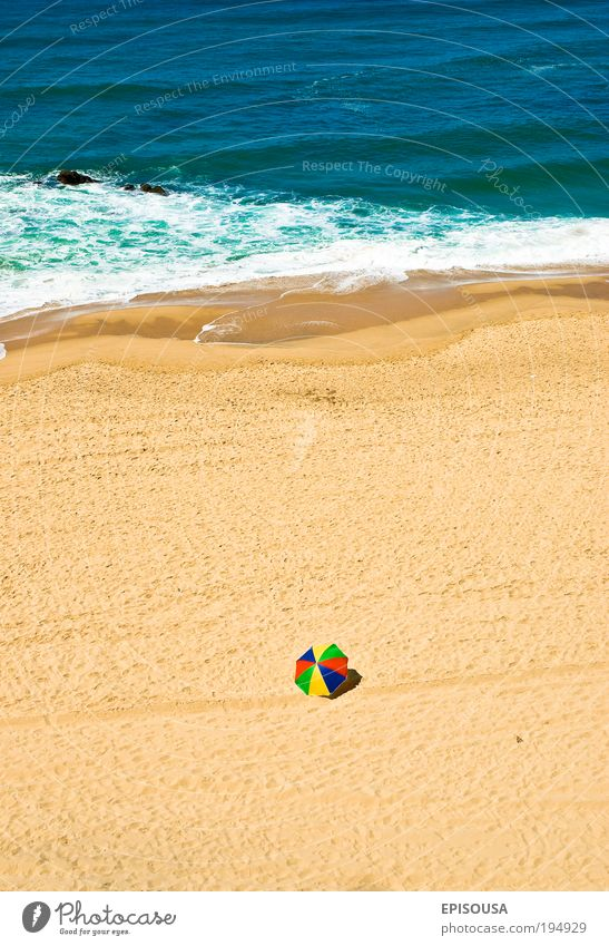 Alone on the beach. Nature Water Ocean Red Summer Beach Vacation & Travel Loneliness Sand Coast Tourism Luxury Tourist Portugal Vertical Human being