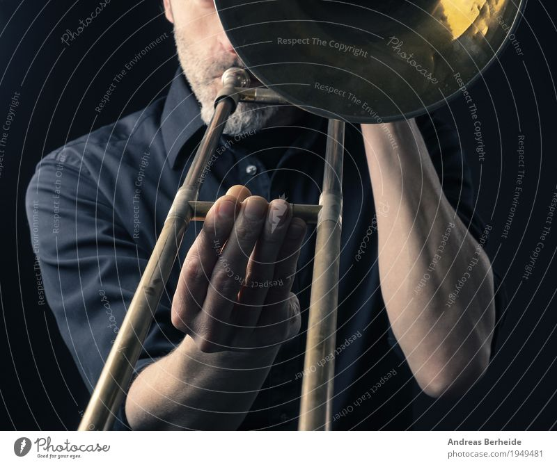 play the trombone Style Music Human being Man Adults 1 30 - 45 years Shows Playing Concentrate Creativity Art Jazz tool Musical Background picture Blues