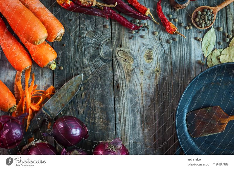 Fresh carrots and red onion with a frying pan Vegetable Fruit Herbs and spices Vegetarian diet Pan Spoon Table Kitchen Wood Metal Old Eating Healthy Juicy Brown