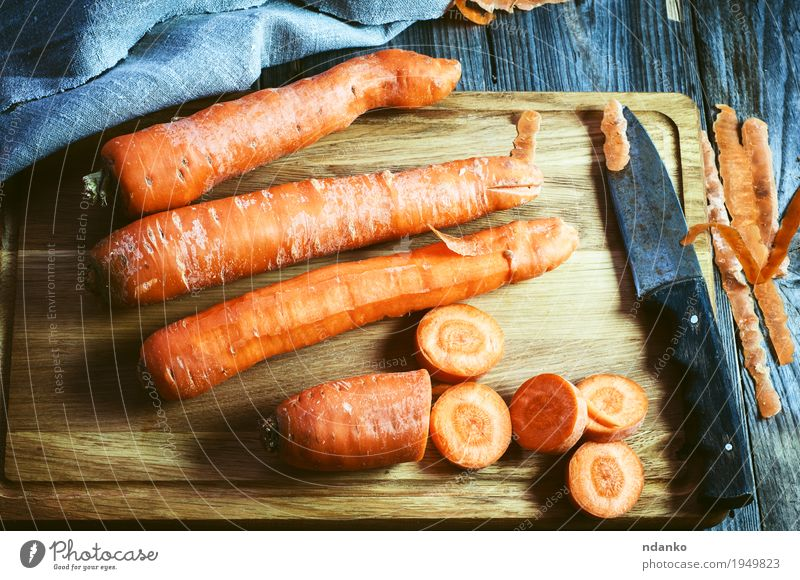 fresh long carrot on a chopping board Nature Eating Natural Wood Above Orange Nutrition Fresh Retro Table Vegetable Harvest Vegetarian diet Diet Vitamin Tablecloth