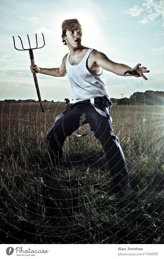 Action Farmer Human being Masculine Young man Youth (Young adults) 18 - 30 years Adults Field Underwear Cap Looking Stand Aggression Cool (slang) Dirty