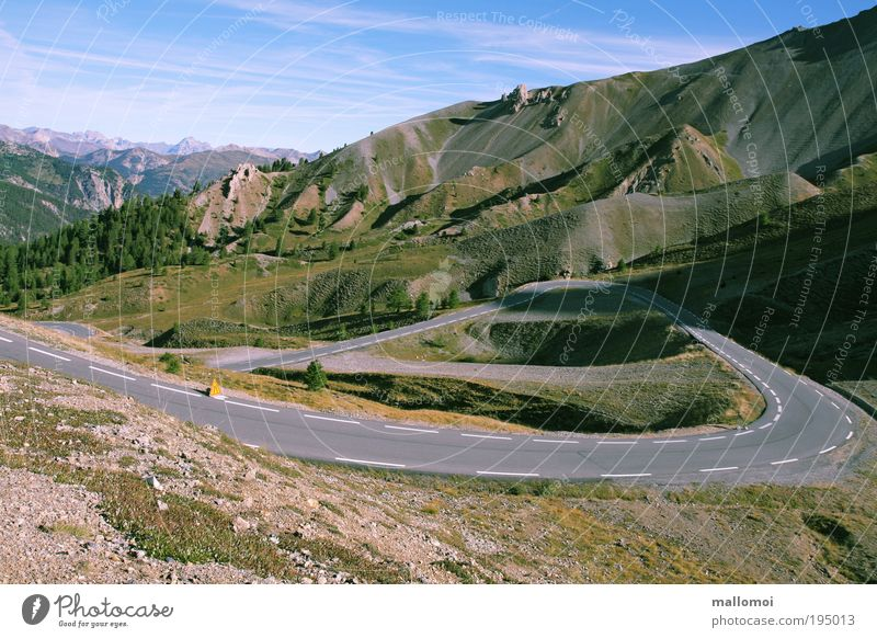 Vacation & Travel Far-off places Environment Landscape Street Mountain Lanes & trails Climate Trip Alps Beautiful weather Vantage point Peak Traffic infrastructure Curve Country road
