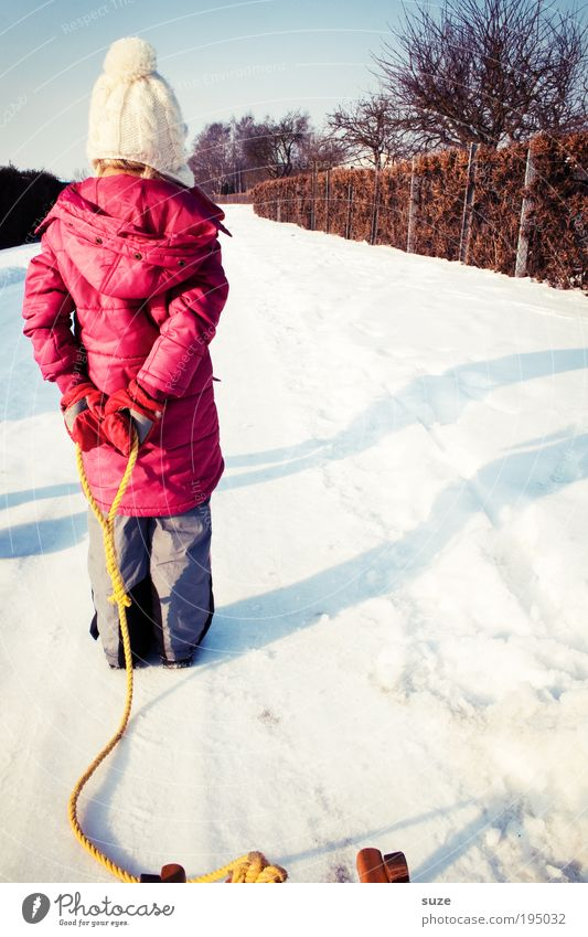 Human being Child Red Girl Winter Joy Cold Snow Playing Lanes & trails Legs Infancy Footwear Back Leisure and hobbies Hiking