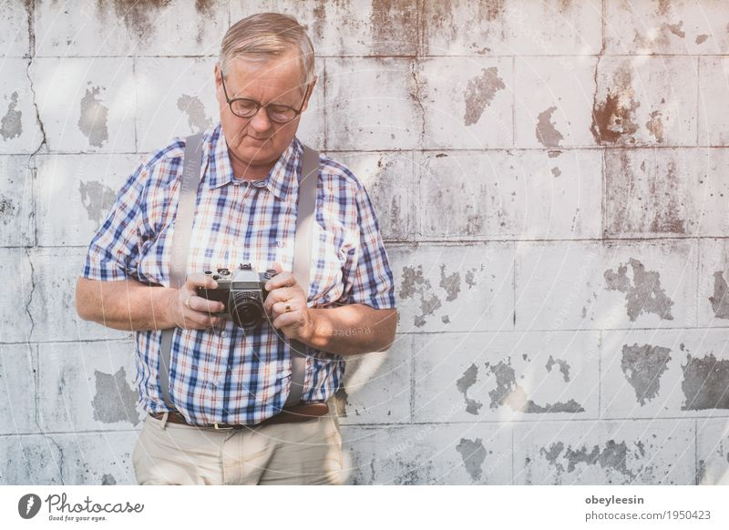 older hipster man with a old vintage camera Lifestyle Style Design Joy Save Human being Father Adults 1 Art Artist Adventure Colour photo Multicoloured Close-up