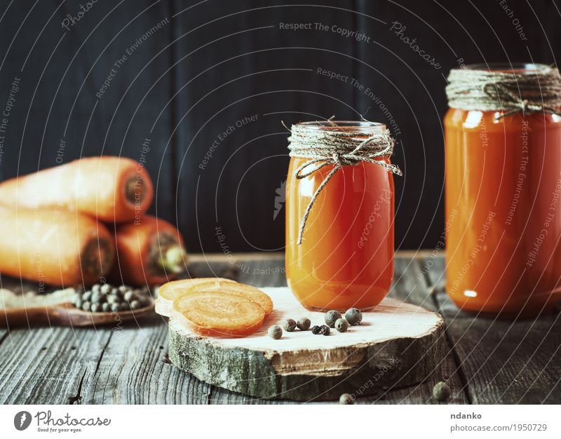 Two glass jars with fresh carrot juice Vegetable Dessert Herbs and spices Eating Breakfast Vegetarian diet Diet Beverage Juice Bottle Spoon Table Kitchen