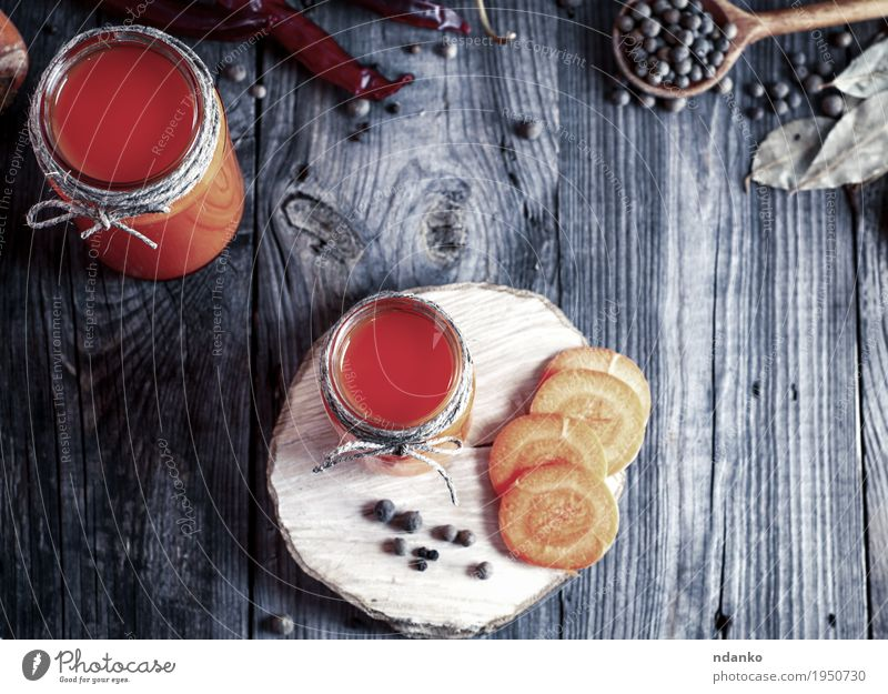 Fresh carrot juice in glass jars, top view Eating Natural Wood Health care Gray Above Orange Bright Fresh Glass Table Herbs and spices Kitchen Drinking Delicious Vegetable
