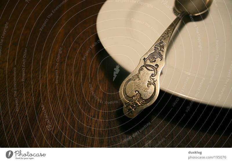 Carl Lunch Dinner Crockery Plate Cutlery Spoon Wood Dark Empty Metal White Brown Gravure Legacy Name Possessions Personal Colour photo Interior shot Close-up