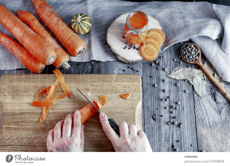 process of slicing fresh carrots on a chopping board Human being Woman Youth (Young adults) Old Hand 18 - 30 years Adults Eating Wood Health care Gray Orange Nutrition Fresh Glass Table