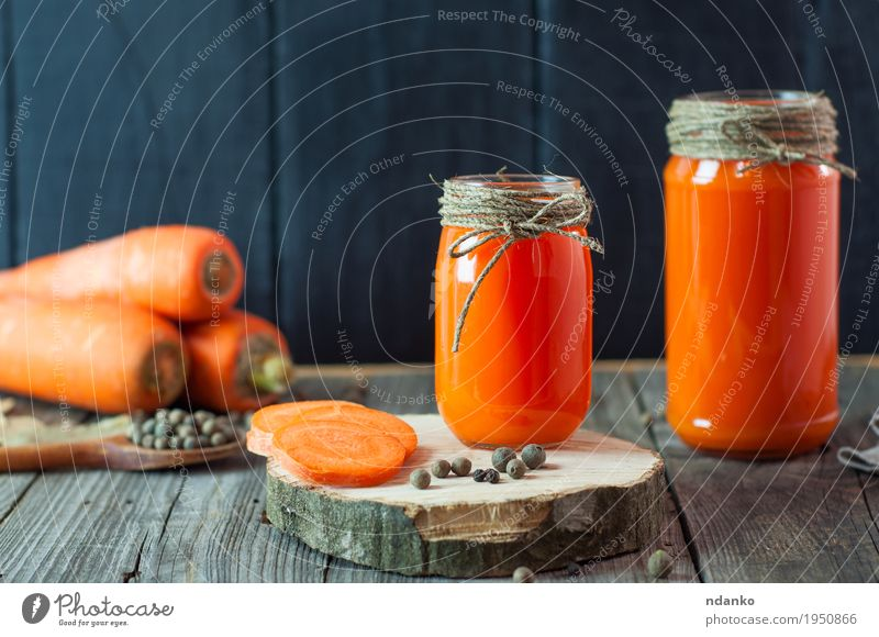 Two glass jars with fresh carrot juice Eating Natural Healthy Wood Health care Orange Bright Fresh Glass Table Herbs and spices Kitchen Delicious Vegetable