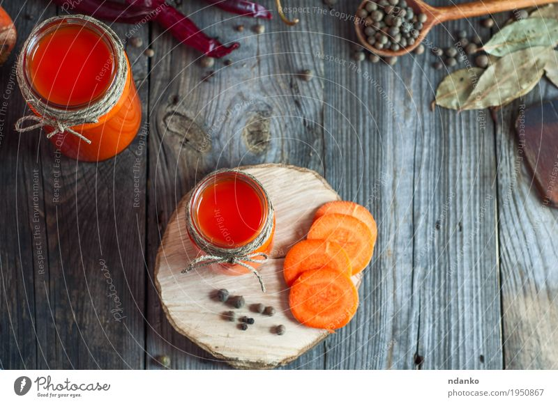 Fresh carrot juice in glass jars, top view Red Eating Healthy Gray Above Orange Bright Table Herbs and spices Kitchen Drinking Vegetable Breakfast Home Cup