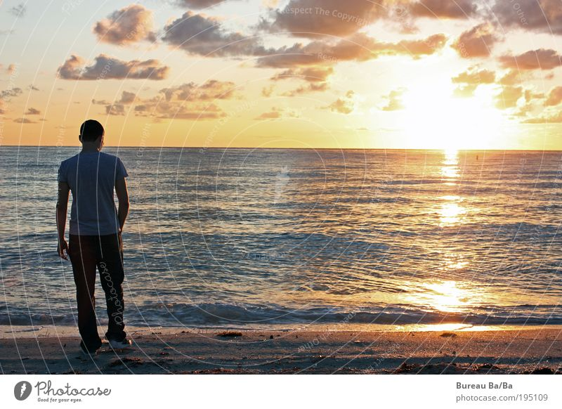 Human being Man Youth (Young adults) Water Sky Ocean Clouds Happy Sand Contentment Moody Power Orange Adults Masculine USA