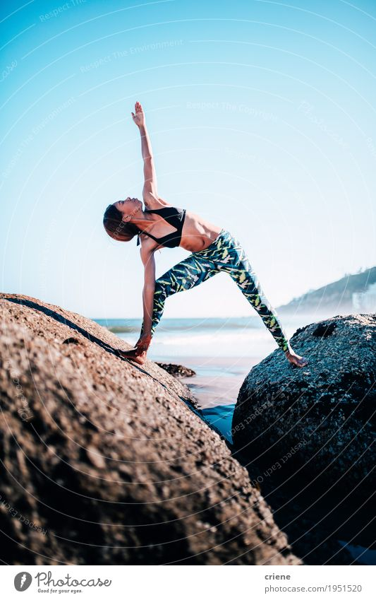 Women doing yoga on rocks at the beach in the morning Woman Youth (Young adults) Blue Summer Young woman Beautiful Relaxation Beach Adults Life Lifestyle Sports Healthy Feminine Sand Rock
