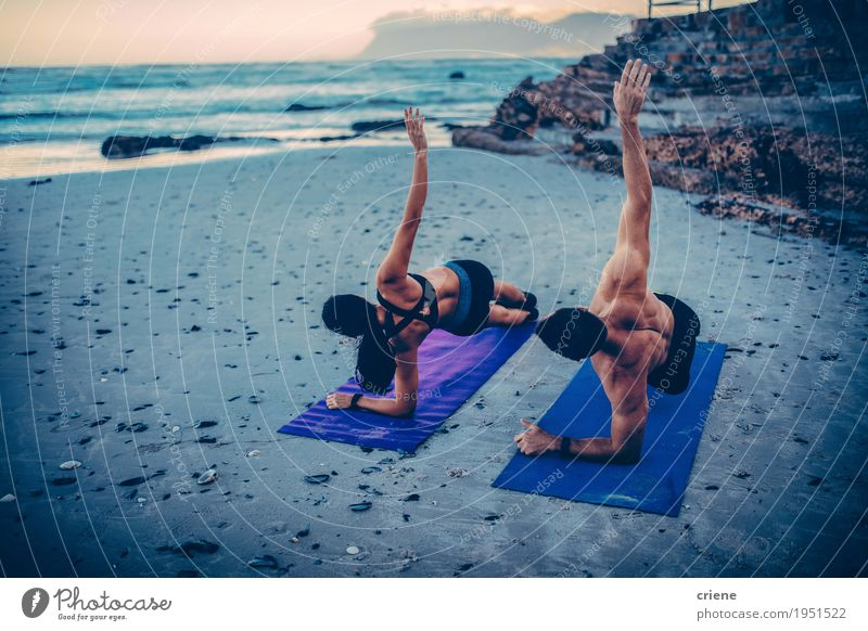 Young adult couple doing fitness exercises on the beach Lifestyle Personal hygiene Healthy Wellness Well-being Leisure and hobbies Beach Ocean Waves Sports