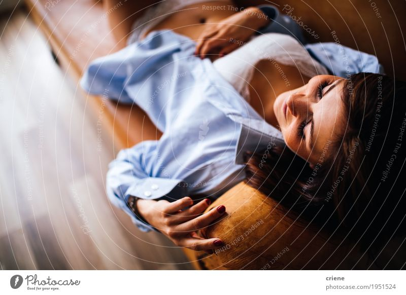 Young caucasian women laying on couch. Human being Woman Youth (Young adults) Young woman Eroticism Relaxation Adults Lifestyle Natural Feminine