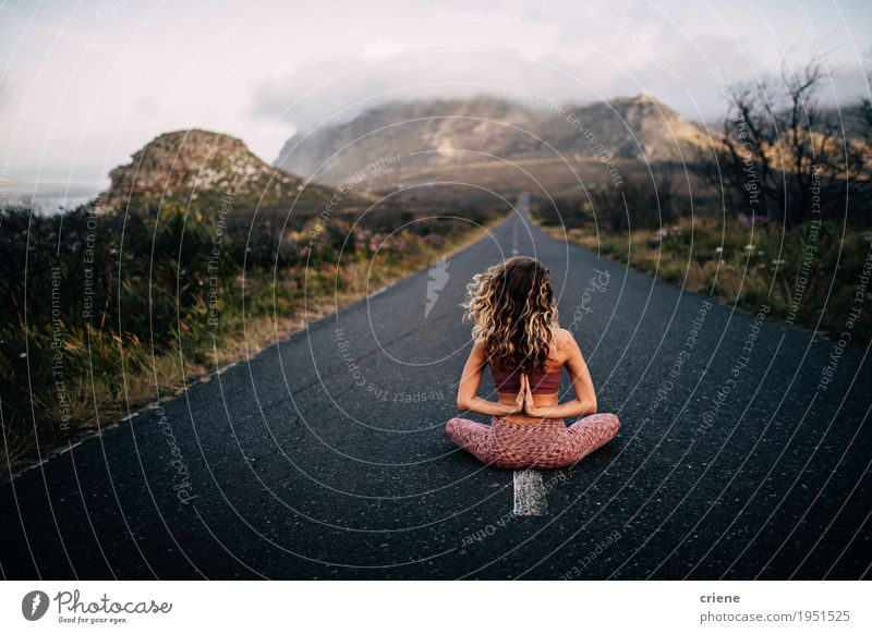 Young caucasian women doing namaste yoga pose on road Lifestyle Happy Personal hygiene Harmonious Well-being Vacation & Travel Trip Adventure Freedom Mountain