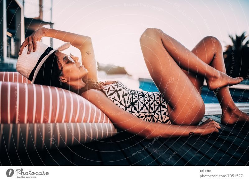 Young female adult laying relaxed at swimming pool Woman Vacation & Travel Youth (Young adults) Summer Young woman Eroticism Relaxation Joy Adults Lifestyle Feminine Swimming & Bathing Lie Body Happiness To enjoy