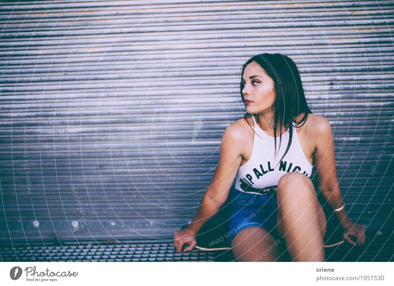Young caucasian women sitting on skateboard in the street Human being Woman Youth (Young adults) Young woman Relaxation Joy 18 - 30 years Adults Street Lifestyle Sports Feminine Fashion Leisure and hobbies Sit Brunette