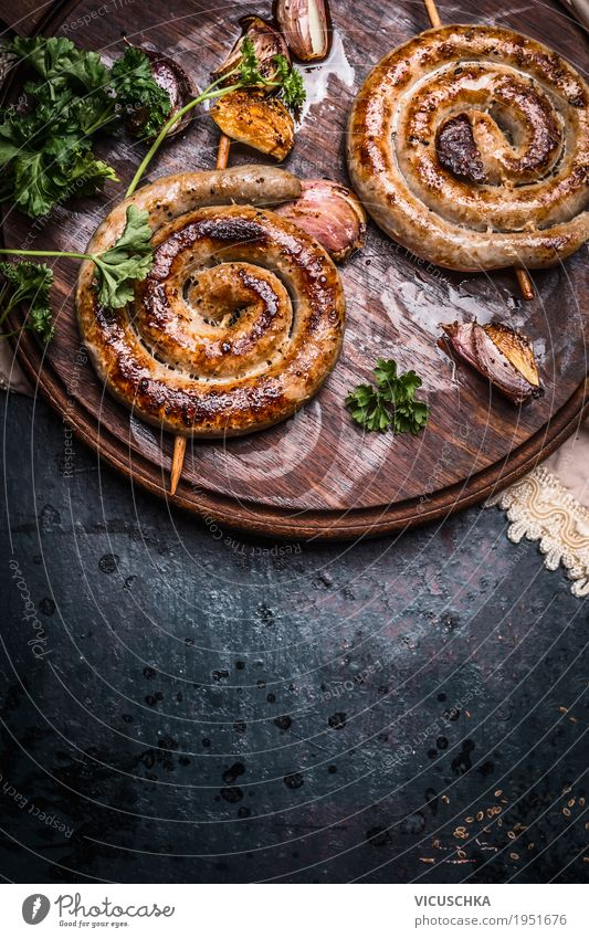 Grilled sausages with garlic and spices Food Sausage Nutrition Design Table Barbecue (apparatus) Style Bratwurst Gourmet Snack Food photograph Rustic