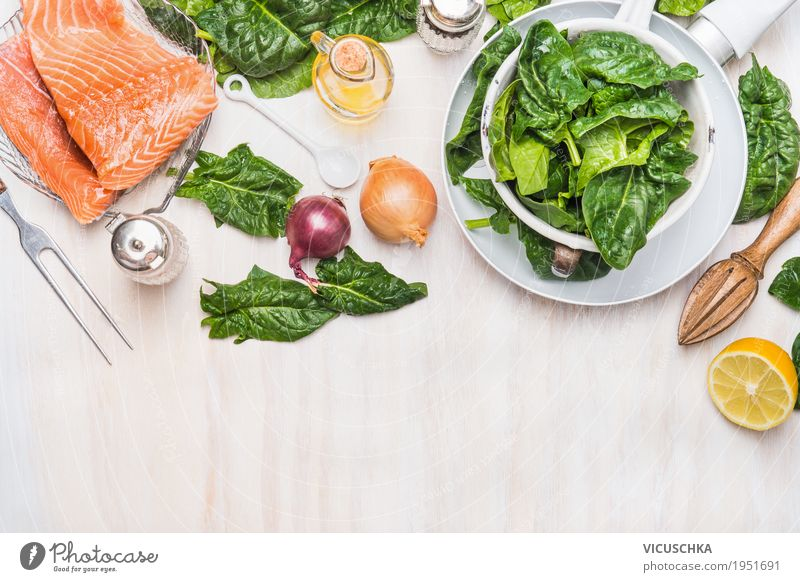 Raw salmon fillet with spinach Food Fish Vegetable Herbs and spices Nutrition Lunch Dinner Vegetarian diet Diet Crockery Pan Cutlery Style Design Healthy