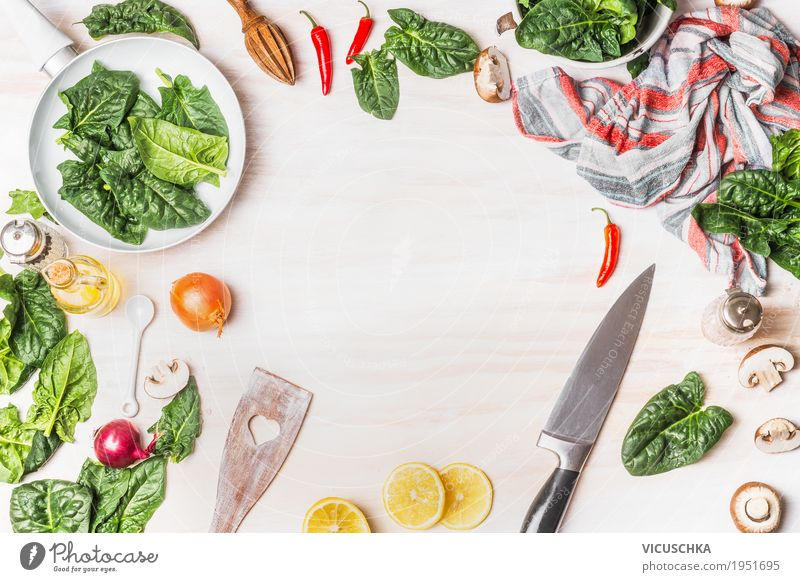 Healthy vegetarian cooking with spinach Food Vegetable Herbs and spices Nutrition Organic produce Vegetarian diet Diet Crockery Pot Pan Knives Spoon Style