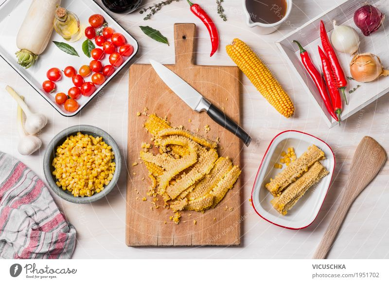 Corn cooking, preparation with chopping board, knife and ingredients Food Vegetable Herbs and spices Cooking oil Nutrition Lunch Dinner Organic produce