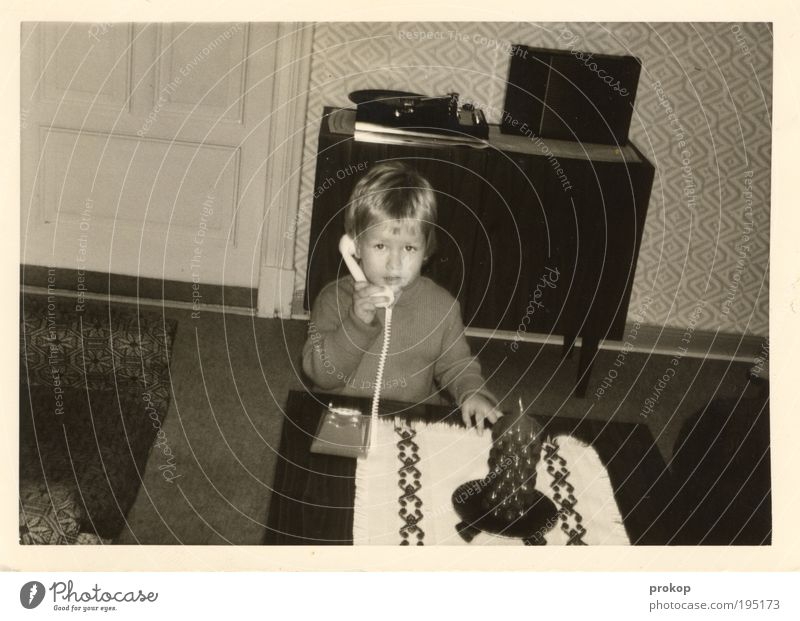 Human being Child Boy (child) Playing Flat (apartment) To talk Table Retro Candle Telecommunications Living or residing Interior design Wallpaper Infancy