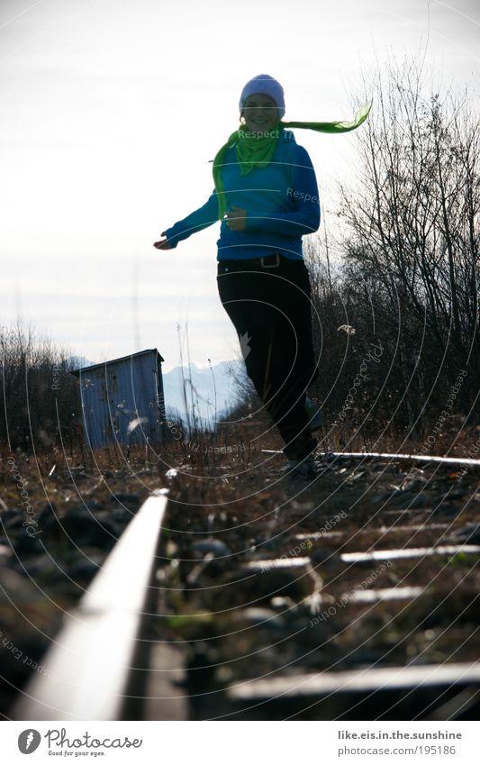 Shaaaaaaaaaaaaaaaatz! Jogging Feminine Young woman Youth (Young adults) 1 Human being Nature Plant Sky Winter Hut Railroad tracks Stone Metal Smiling Laughter